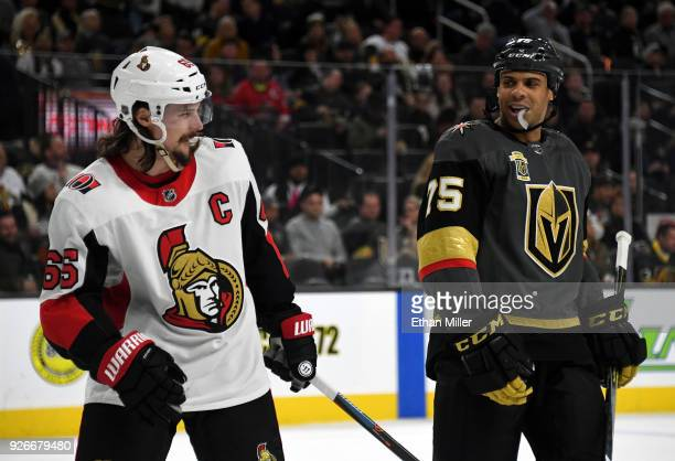 Erik Karlsson of the Ottawa Senators and Ryan Reaves of the Vegas Golden Knights talk while waiting for a faceoff in the second period of their game...