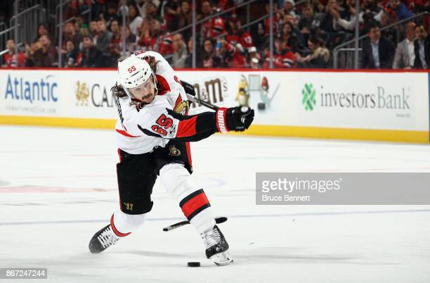 Erik Karlsson of the Ottawa Senators breaks his stick taking a third period shot against the New Jersey Devils at the Prudential Center on October 27...