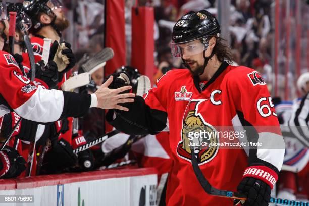 Erik Karlsson of the Ottawa Senators celebrates a third period game tying goal scored by teammate Derick Brassard against the New York Rangers in...