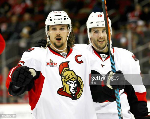 Erik Karlsson of the Ottawa Senators celebrates his goal as teammate Derick Brassard stands by in the third period against the New Jersey Devils on...
