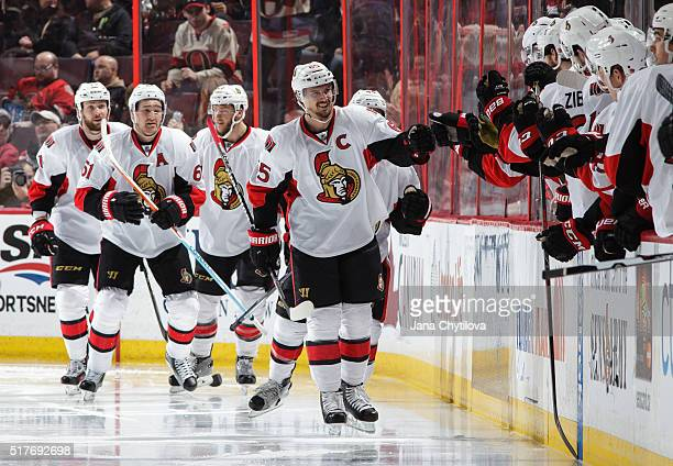 Erik Karlsson of the Ottawa Senators celebrates his second period goal with team mates Mark Stone Zack Smith and Fredrik Claesson against the Anaheim...