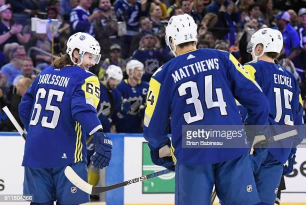 Erik Karlsson of the Ottawa Senators celebrates with Auston Matthews of the Toronto Maple Leafs and Jack Eichel of the Buffalo Sabres during the 2018...