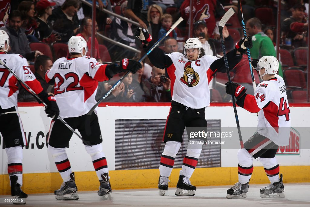 Erik Karlsson #65 (second from right) of the Ottawa Senators celebrates with Chris Kelly #22 and Jean-Gabriel Pageau #44 after Karlsson scored the game winning goal against the Arizona Coyotes during overtime of the NHL game at Gila River Arena on March 9, 2017 in Glendale, Arizona. The Senators defeated the Coyotes 3-2 in overtime.