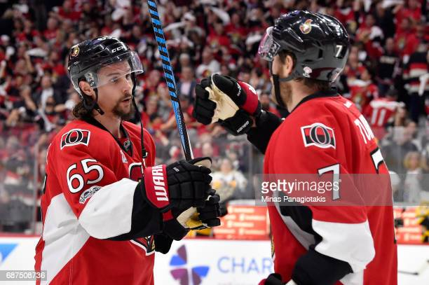 Erik Karlsson of the Ottawa Senators celebrates with Kyle Turris after defeating the Pittsburgh Penguins with a score of 2 to 1 in Game Six of the...