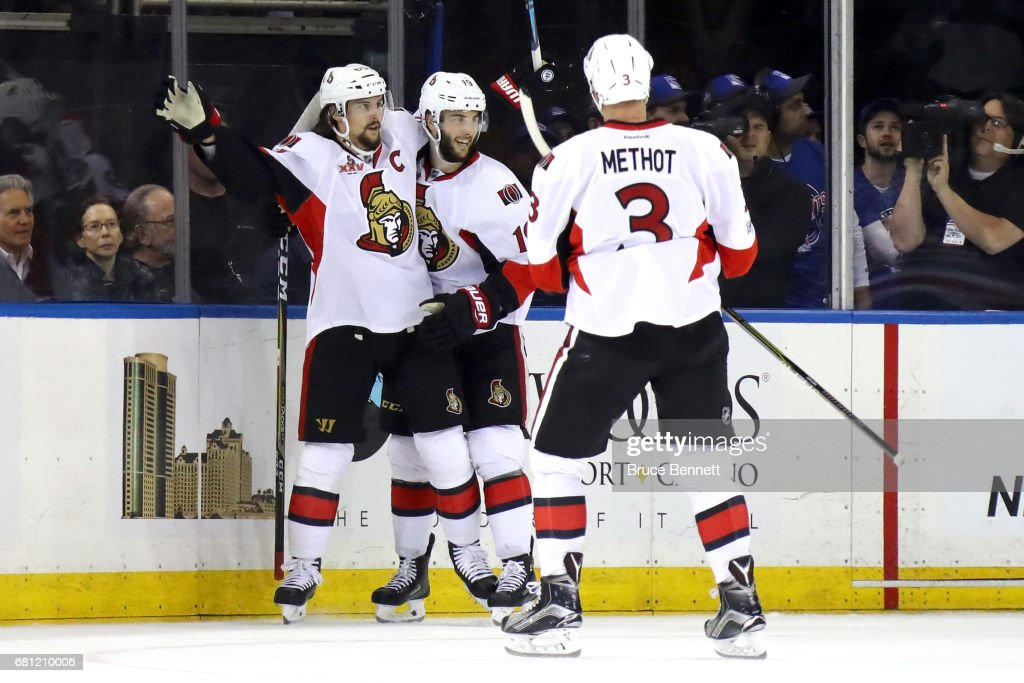 Erik Karlsson #65 of the Ottawa Senators celebrates with teammates Derick Brassard #19 and Marc Methot #3 after scoring a goal against Henrik Lundqvist #30 of the New York Rangers during the second period in Game Six of the Eastern Conference Second Round during the 2017 NHL Stanley Cup Playoffs at Madison Square Garden on May 9, 2017 in New York City.