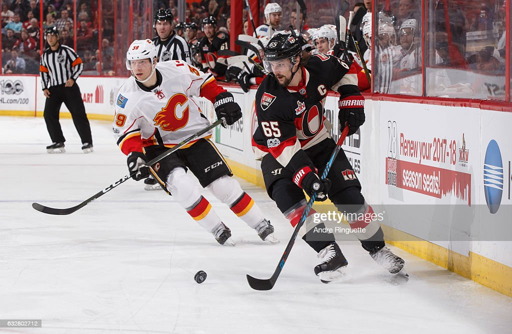 Erik Karlsson #65 of the Ottawa Senators controls the puck against Alex Chiasson #39 of the Calgary Flames at Canadian Tire Centre on January 26, 2017 in Ottawa, Ontario, Canada.