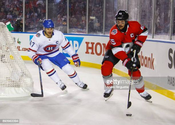 Erik Karlsson of the Ottawa Senators controls the puck against Max Pacioretty of the Montreal Canadiens in the 2017 Scotiabank NHL100 Classic at...