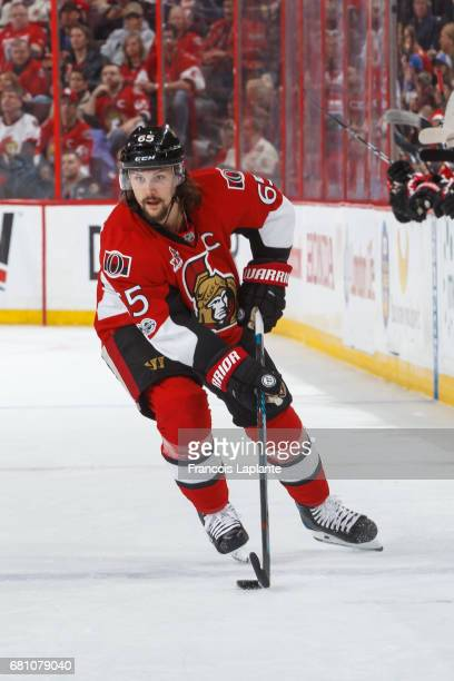 Erik Karlsson of the Ottawa Senators controls the puck against the New York Rangers in Game Five of the Eastern Conference Second Round during the...