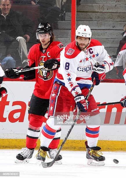 Erik Karlsson of the Ottawa Senators defends against Alex Ovechkin of the Washington Capitals at Canadian Tire Centre on April 4, 2015 in Ottawa,...