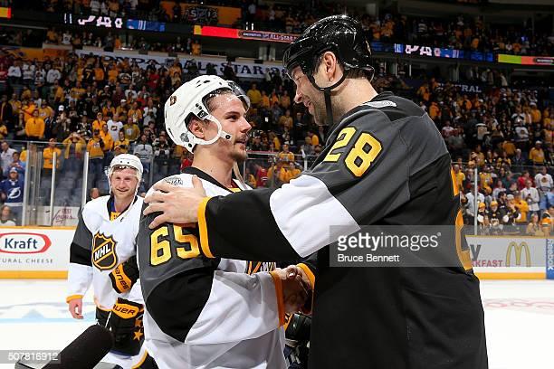 Erik Karlsson of the Ottawa Senators greets John Scott of the Arizona Coyotes after the 2016 Honda NHL All-Star Final Game between the Eastern...