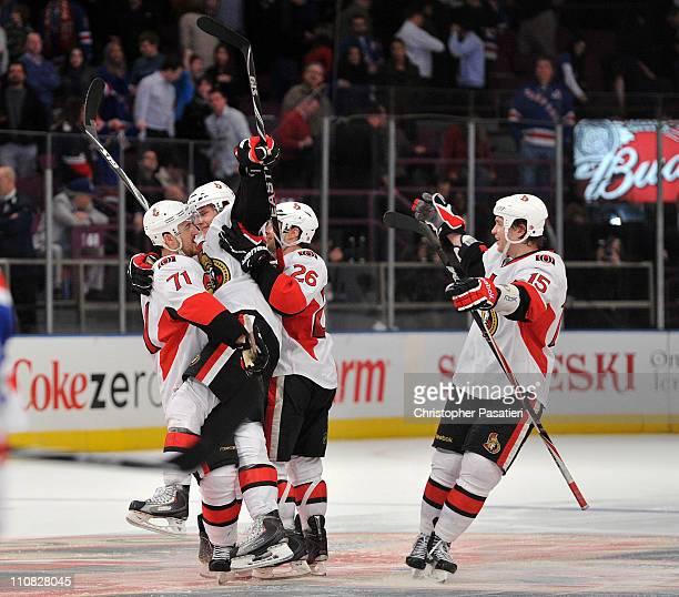 Erik Karlsson of the Ottawa Senators is congratulated by Nick Foligno Ryan Shannon and Zack Smith after scoring the game winning goal to defeat the...