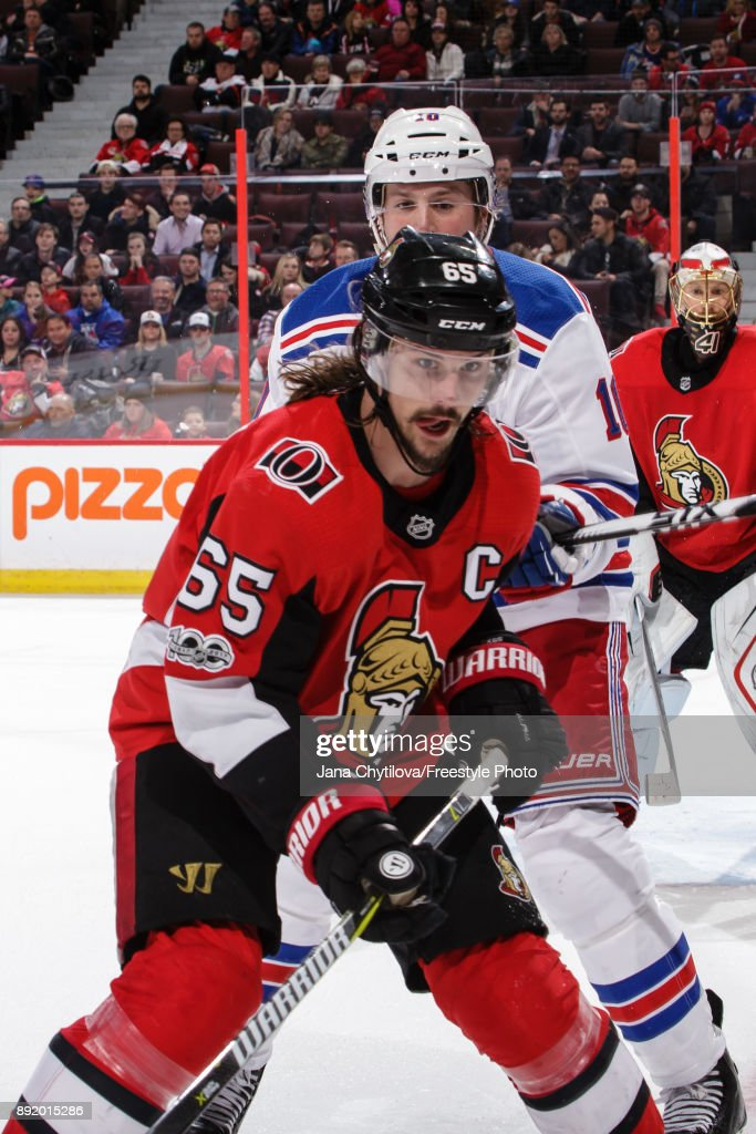 Erik Karlsson #65 of the Ottawa Senators skates for the puck against J.T. Miller #10 of the New York Rangers at Canadian Tire Centre on December 13, 2017 in Ottawa, Ontario, Canada.