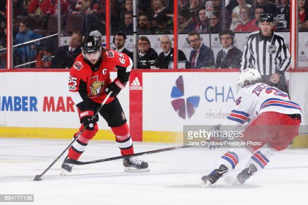 Erik Karlsson of the Ottawa Senators skates with the puck against Mats Zuccarello of the New York Rangers at Canadian Tire Centre on December 13 2017...