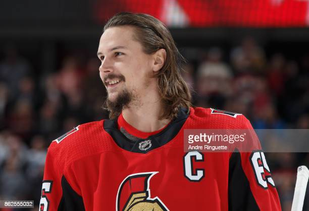 Erik Karlsson of the Ottawa Senators smiles before the singing of the national anthem prior to a game against the Vancouver Canucks at Canadian Tire...