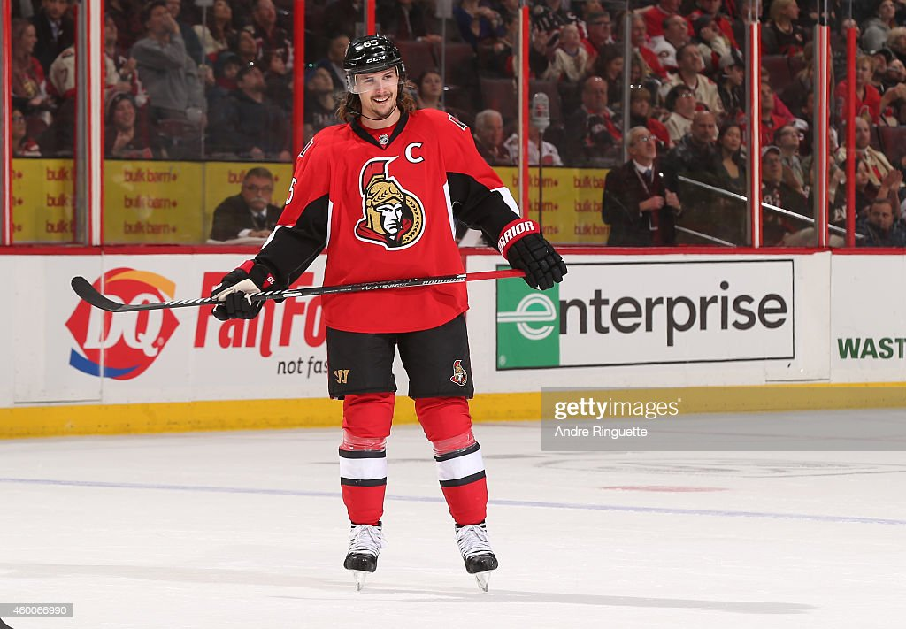 Erik Karlsson #65 of the Ottawa Senators smiles during a game against the New York Islanders at Canadian Tire Centre on December 4, 2014 in Ottawa, Ontario, Canada.
