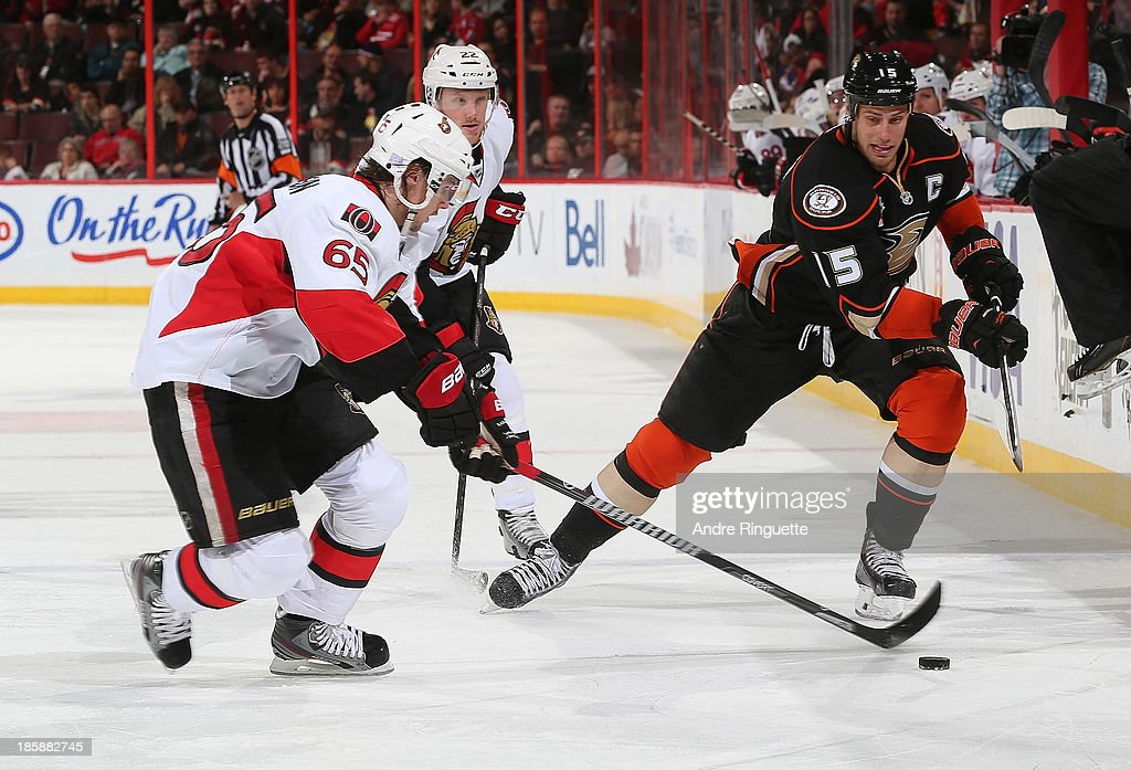 Erik Karlsson #65 of the Ottawa Senators stickhandles the puck against Ryan Getzlaf #15 of the Anaheim Ducks at Canadian Tire Centre on October 25, 2013 in Ottawa, Ontario, Canada.