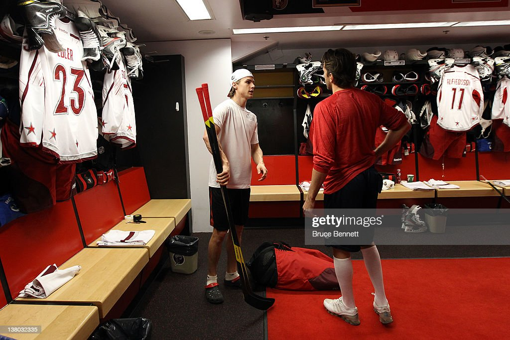 cheap for discount e6089 d0867 Erik Karlsson of the Ottawa Senators talks with Henrik ...