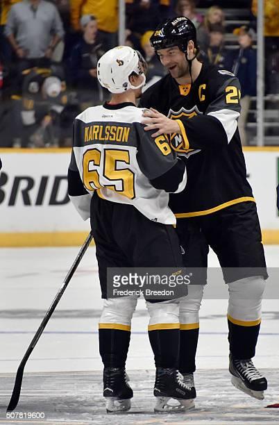 Erik Karlsson of the Ottawa Senators talks with John Scott of the Arizona Coyotes after the 2016 Honda NHL AllStar Final Game between the Eastern...