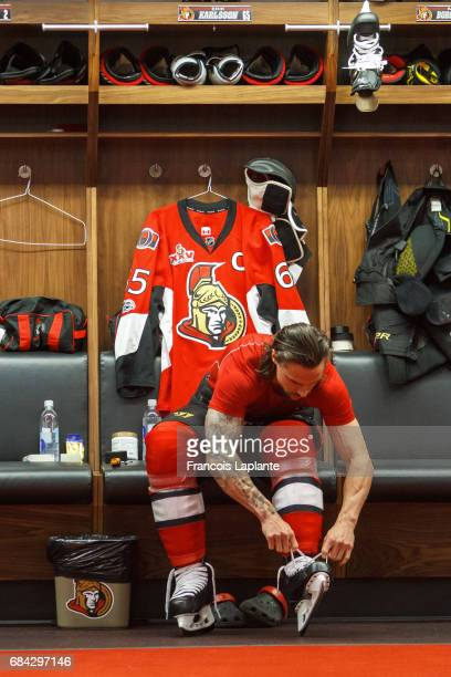 Erik Karlsson of the Ottawa Senators ties up his skates prior to warmup in Game Three of the Eastern Conference Final against the Pittsburgh Penguins...