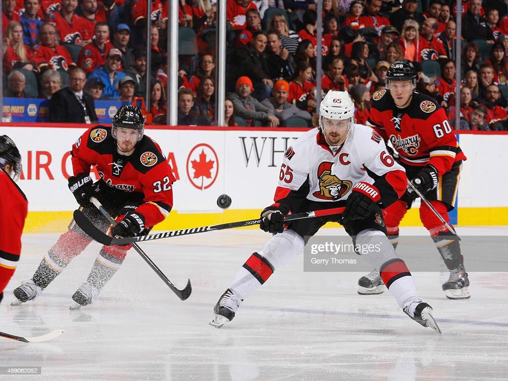 Erik Karlsson #65 of the Ottawa Senators tracks the puck through the air against the Calgary Flames at Scotiabank Saddledome on November 15, 2014 in Calgary, Alberta, Canada.