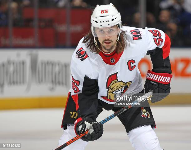Erik Karlsson of the Ottawa Senators waits for a puck drop against the Toronto Maple Leafs during an NHL game at the Air Canada Centre on February 10...