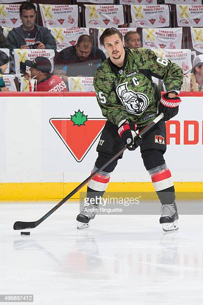 Erik Karlsson of the Ottawa Senators wears a camouflage jersey during warmup on Canadian Forces Appreciation Night prior to a game against the...
