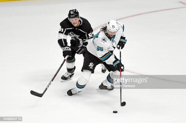 Erik Karlsson of the San Jose Sharks handles the puck against Austin Wagner of the Los Angeles Kings at STAPLES Center on October 5 2018 in Los...