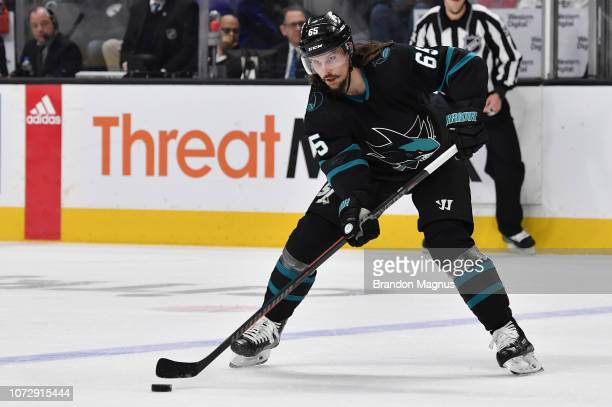 Erik Karlsson of the San Jose Sharks makes a pass against the Dallas Stars at SAP Center on December 13 2018 in San Jose California
