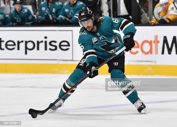 Erik Karlsson of the San Jose Sharks passes the puck ahead against the Nashville Predators at SAP Center on November 13 2018 in San Jose California