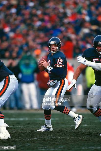 Erik Kramer of the Chicago Bears drops back to pass against the Tampa Bay Buccaneers during an NFL football game December 17 1995 at Soldier Field in...