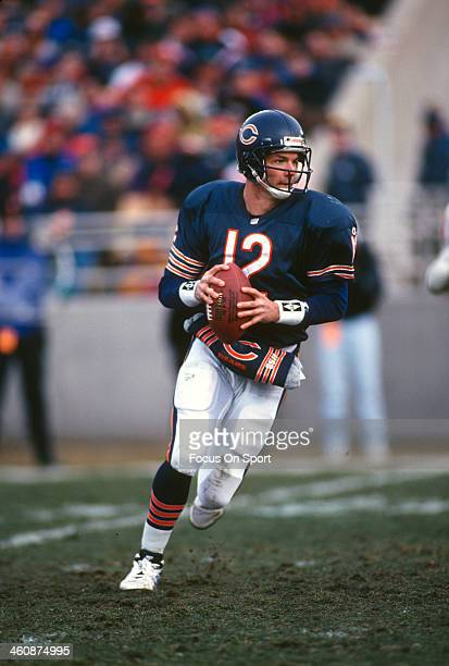 Erik Kramer of the Chicago Bears rolls out to pass against the Tampa Bay Buccaneers during an NFL football game December 17 1995 at Soldier Field in...