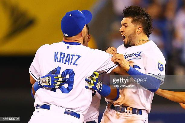 Erik Kratz and Eric Hosmer of the Kansas City Royals celebrate their 9 to 8 win over the Oakland Athletics in the 12th inning of their American...