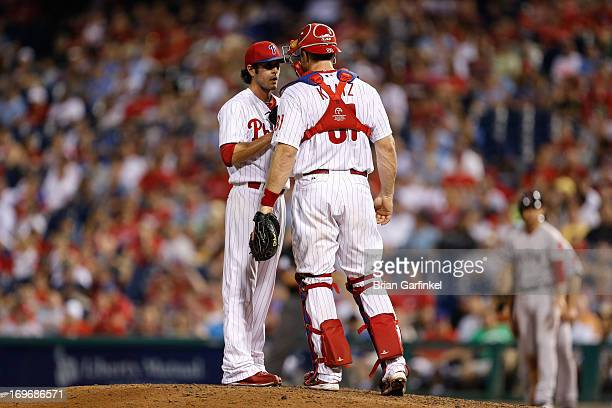 Erik Kratz and Michael Stutes of the Philadelphia Phillies talk on the mound in the eighth inning of the game against the Boston Red Sox at Citizens...