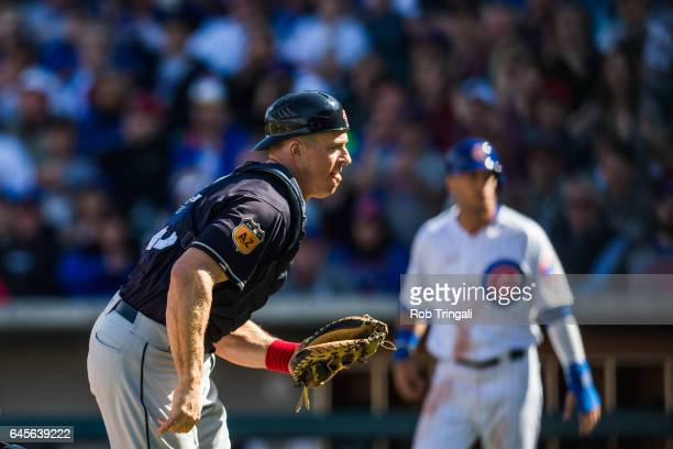 Erik Kratz of the Cleveland Indians defends his position during a spring training game against the Chicago Cubs at Sloan Park on February 26 2017 in...