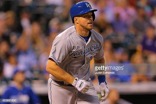 Erik Kratz of the Kansas City Royals watches his RBI sacrifice fly during the fourth inning against the Colorado Rockies at Coors Field on August 20...