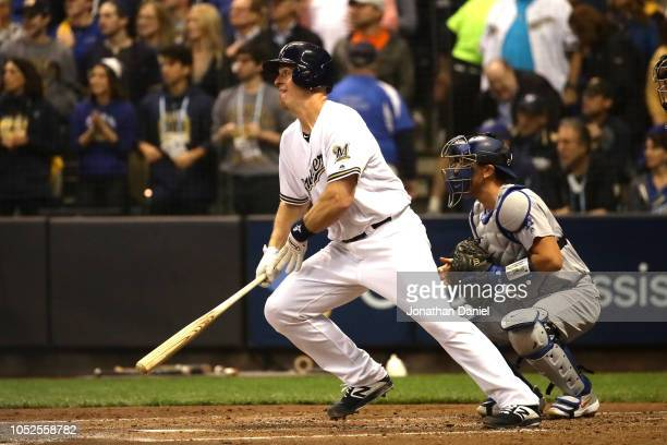 Erik Kratz of the Milwaukee Brewers hits an RBI single to score Mike Moustakas against HyunJin Ryu of the Los Angeles Dodgers during the first inning...