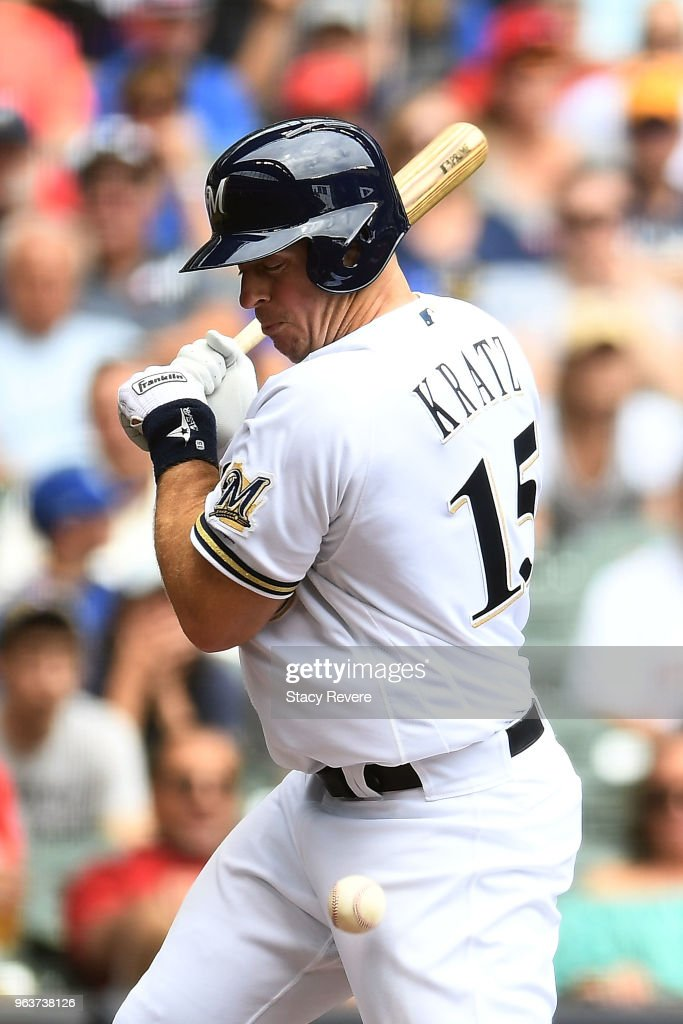 Erik Kratz #15 of the Milwaukee Brewers is hit by a pitch during the second inning of a game against the St. Louis Cardinals at Miller Park on May 30, 2018 in Milwaukee, Wisconsin.