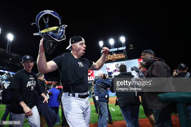 Erik Kratz of the New York Yankees celebrates their 5 to 2 win over the Cleveland Indians in Game Five of the American League Divisional Series at...