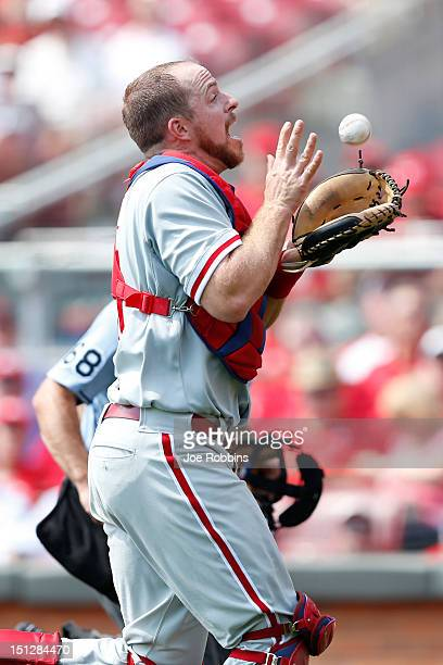 Erik Kratz of the Philadelphia Phillies catches a foul ball during the game against the Cincinnati Reds at Great American Ball Park on September 5,...