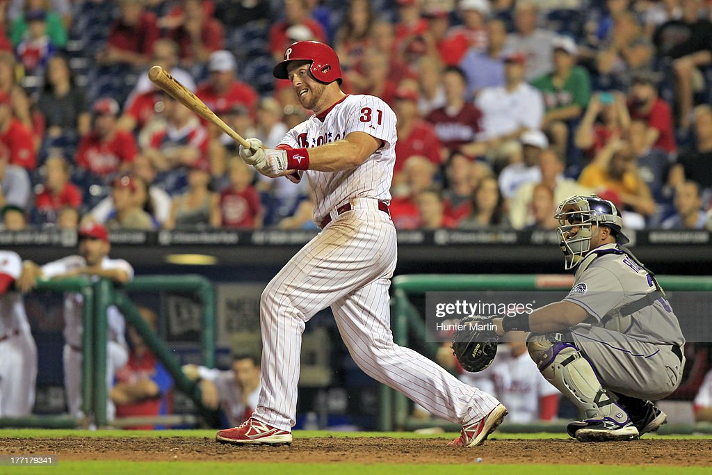 Erik Kratz #31 of the Philadelphia Phillies doubles in the ninth inning during a game against the Colorado Rockies at Citizens Bank Park on August 21, 2013 in Philadelphia, Pennsylvania. The Phillies won 4-3.