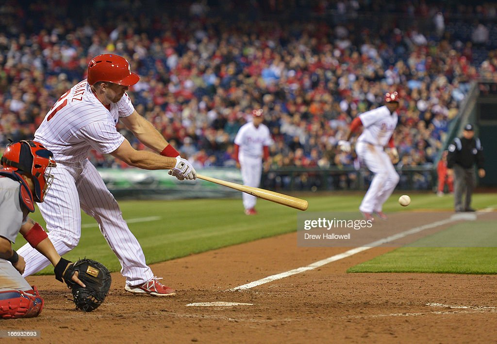 Erik Kratz #31 of the Philadelphia Phillies hits a one run single as John Mayberry Jr. #15 leads off of third base in the seventh inning against the St. Louis Cardinals at Citizens Bank Park on April 18, 2013 in Philadelphia, Pennsylvania. The Cardinals won 4-3.