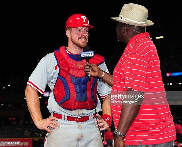 Erik Kratz of the Philadelphia Phillies is interviewed by Gary Matthews after the game against the Atlanta Braves at Turner Field on August 31 2012...