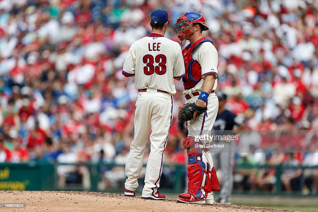Erik Kratz #31 of the Philadelphia Phillies meets on the mound with Cliff Lee #33 in the sixth inning of the game against the Milwaukee Brewers at Citizens Bank Park on June 2, 2013 in Philadelphia, Pennsylvania. The Phillies won 7-5.