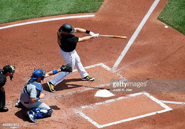 Erik Kratz of the Pittsburgh Pirates hits a two RBI single in the first inning during the game against the Los Angeles Dodgers at PNC Park on June 27...