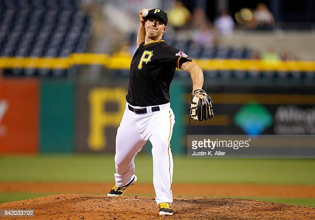 Erik Kratz of the Pittsburgh Pirates pitches in the ninth inning during the game against the San Francisco Giants at PNC Park on June 21 2016 in...