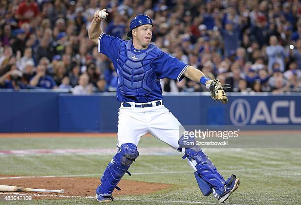 Erik Kratz of the Toronto Blue Jays throws out the baserunner in the eighth inning during MLB game action against the New York Yankees on April 5...