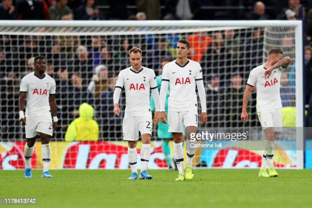 Erik Lamela and Christian Eriksen of Tottenham Hotspur react after FC Bayern Munich's sixth goal during the UEFA Champions League group B match...