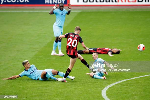 Erik Lamela and Giovani Lo Celso of Tottenham Hotspur fail to stop David Brooks of Bournemouth getting in a shot during the Premier League match...