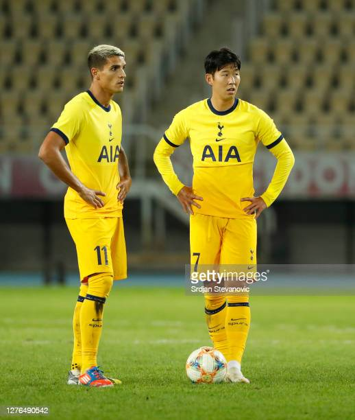 Erik Lamela and HeungMin Son of Tottenham Hotspur prepare to take a free kick during the UEFA Europa League third round qualifying match between...