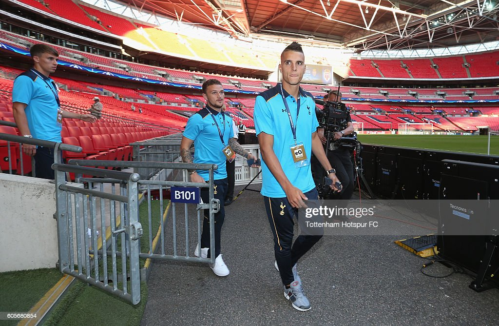 Erik Lamela and Kieran Trippier of Tottenham Hotspur arrive prior to the UEFA Champions League match between Tottenham Hotspur FC and AS Monaco FC at Wembley Stadium on September 14, 2016 in London, England.